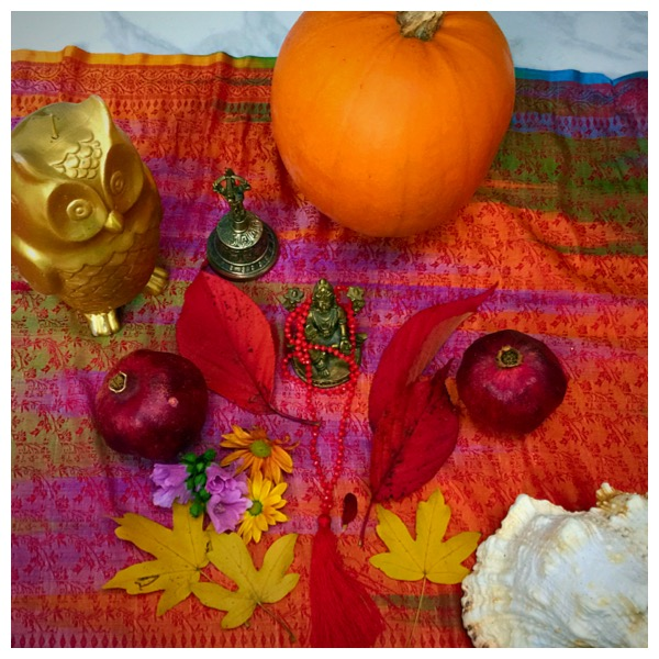 Lakshmi, the bell, conch, pumpkin and pomegranate, leaves, flowers and the owl